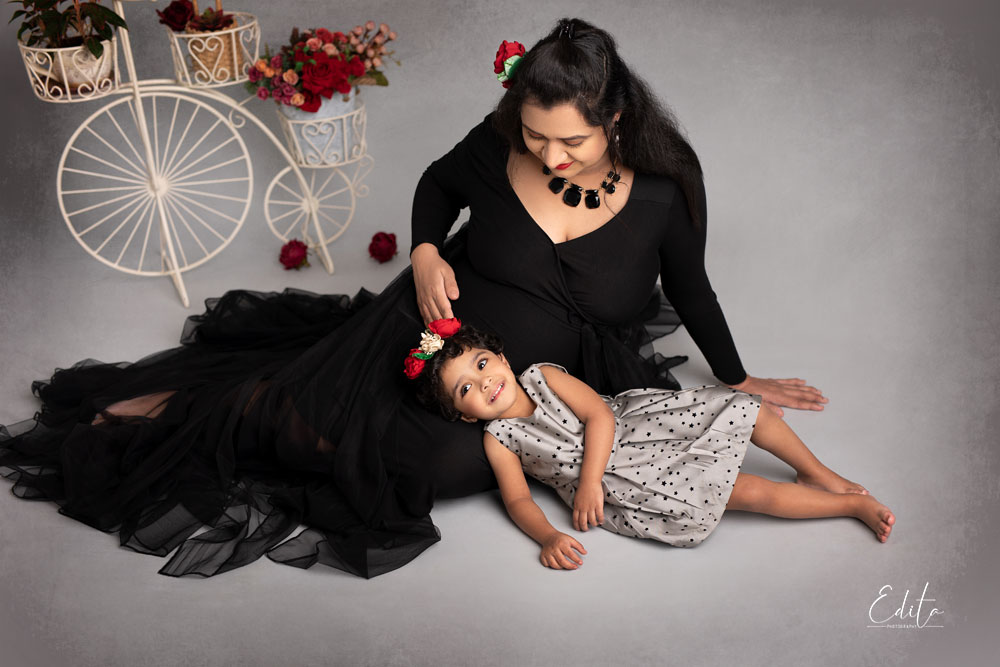 Pregnant Mom in black gown with her daughter