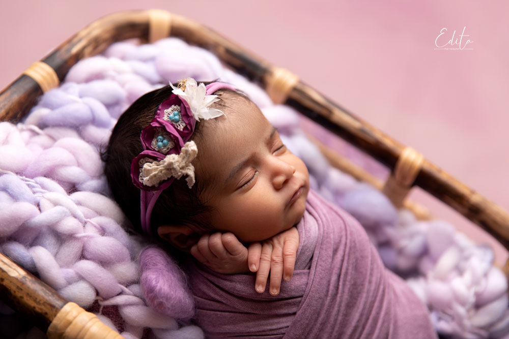 Baby girl in purple