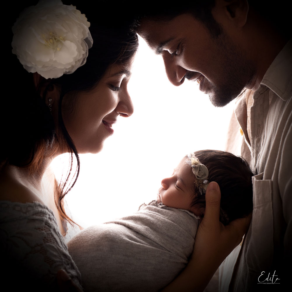 Backlit family photo with newborn