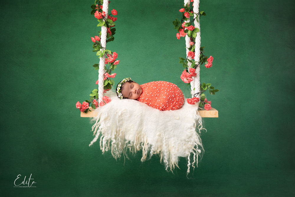Newborn girl on swings