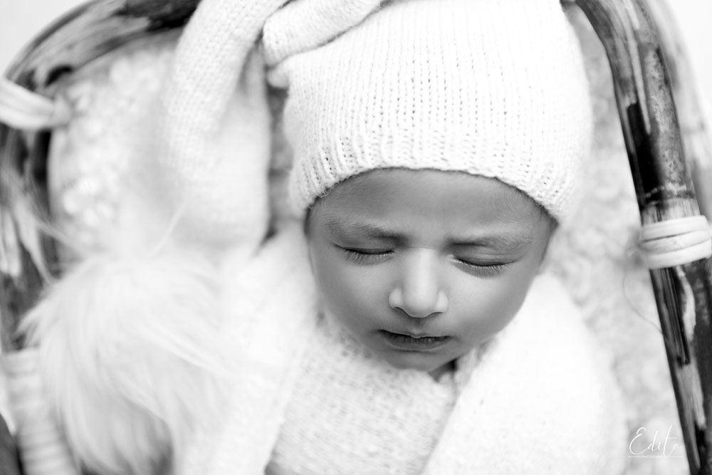 Newborn baby black and white photo with hat