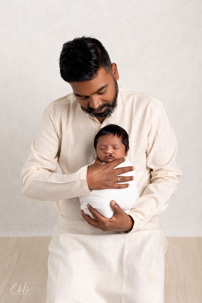Father and newborn son photo in indian traditional attire