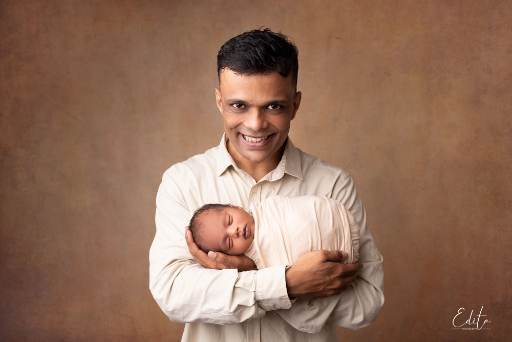 Dad with newborn son photography in Pune