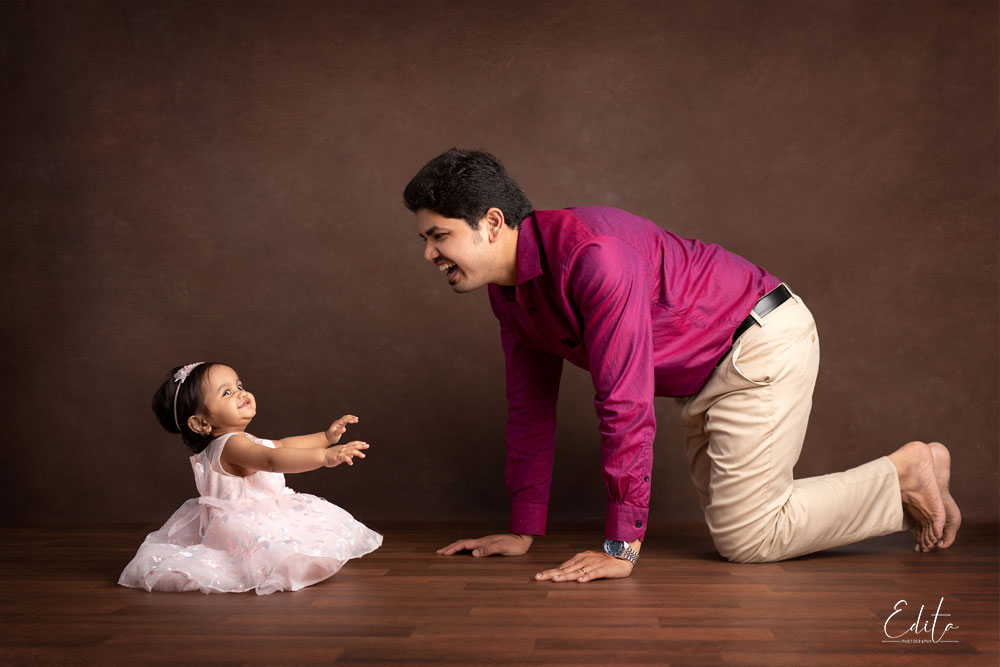 Father is playing with baby girl - daughter, photo session in Pune