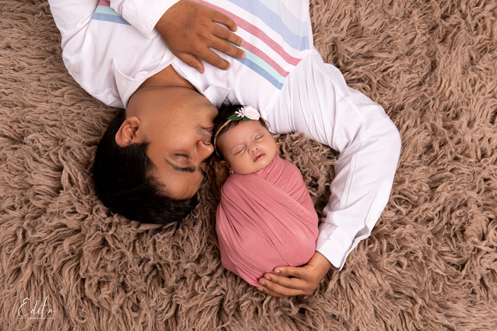 Father with newborn baby girl aerial shoot