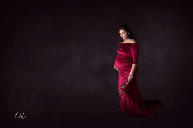 Maternity photo in maroon velvet gown