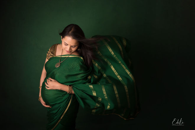 Maternity photoshoot in indian traditional saree