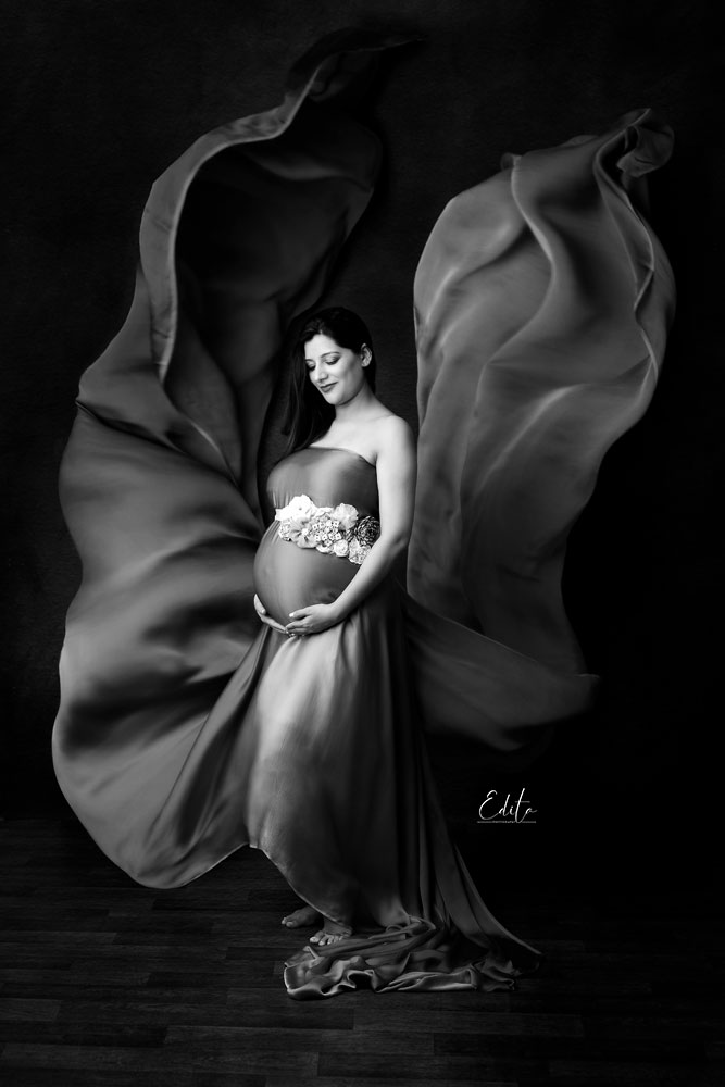 Black and white maternity portrait fabric tossing by Edita Photography