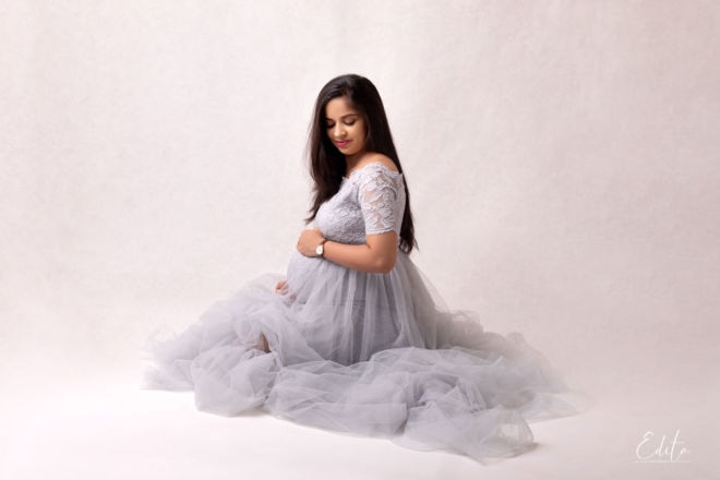 Pregnant woman in grey gown photoshoot at studio in Pune