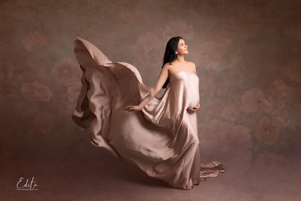 Dusty pink silk fabric tossing for maternity photo shoot Pune