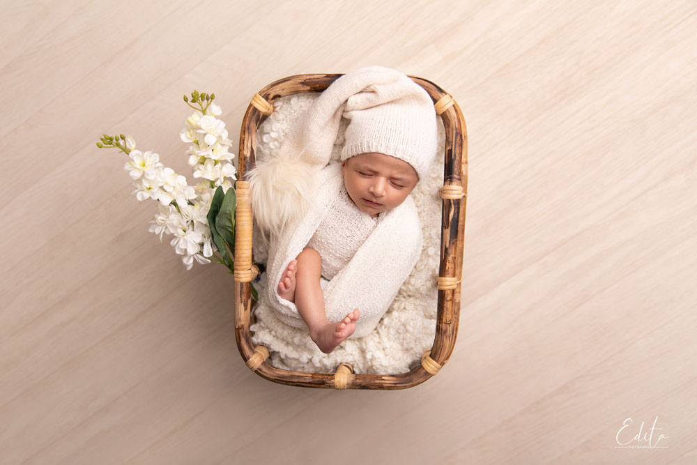 Newborn boy in bamboo basket photoshoot in Pune