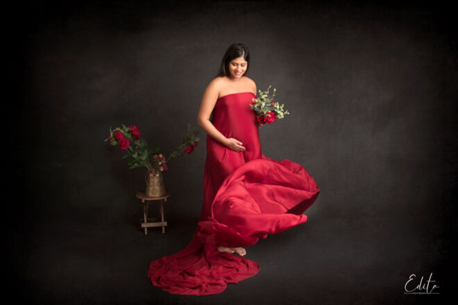 Pregnancy photographer Pune red fabric tossing on black background