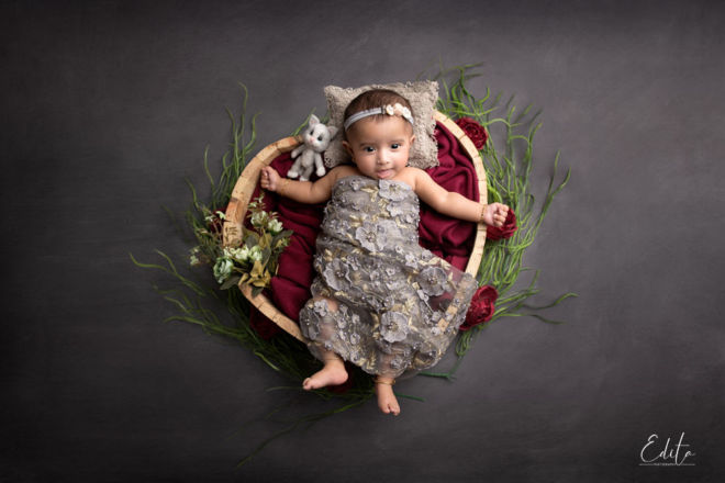 3 month baby girl in heart shaped bowl wrapped in grey wrap by Edita Photography