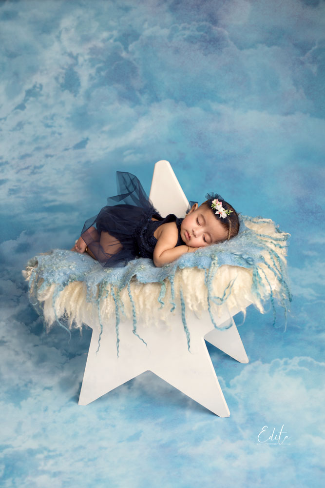 3 month baby girl in navy blue dress on the star prop