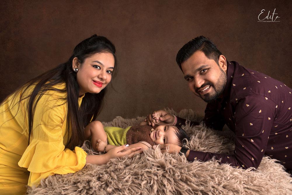 Baby boy with parents portrait