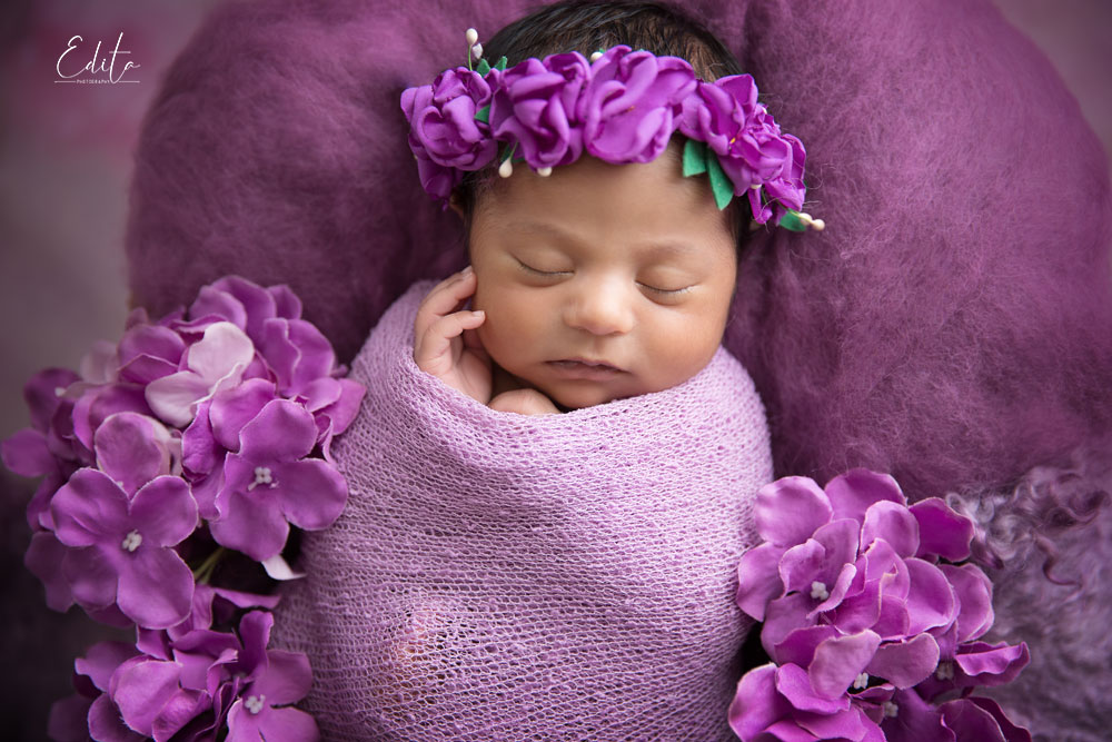 Indian baby girl with purple flowers photography