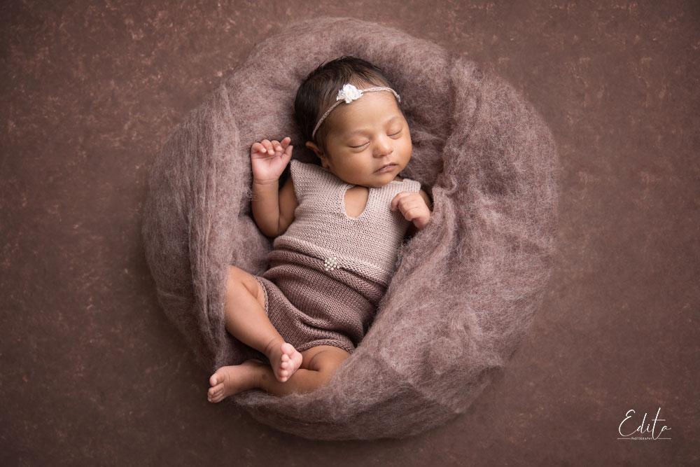 Newborn baby milestone photo shoot, girl in brown wool by best photographer Edita Photography in Pune