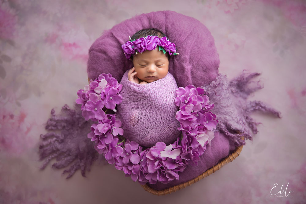 Newborn indian baby milestone photo shoot, girl in purple setup
