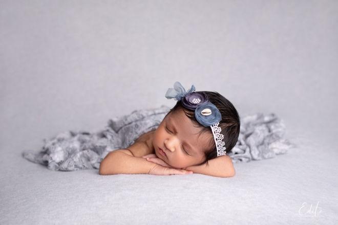 Newborn girl 2 weeks on bean bag sleeping Edita photography