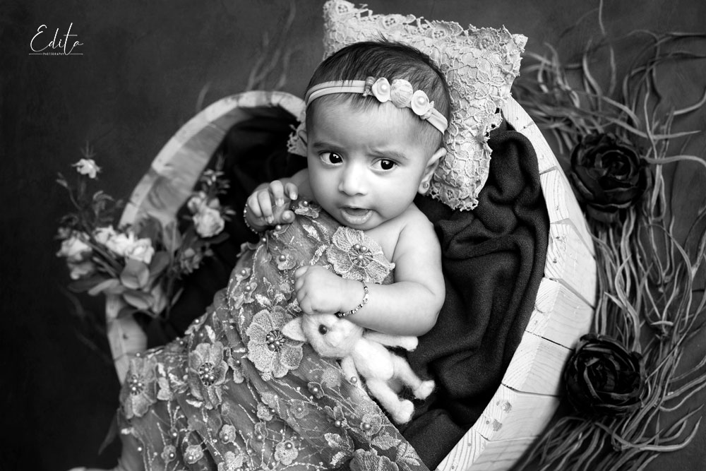 Black and white photo of 3 month baby girl