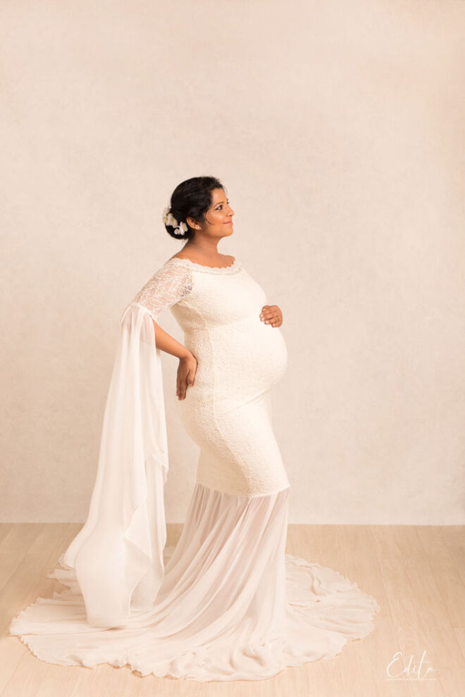 Maternity photography in white long dress