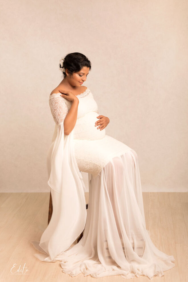 Pregnancy photo shoot in white gown with long sleeves