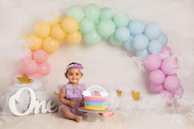 1st pre-birthday photo shoot rainbow cake smash theme in Pune by Edita