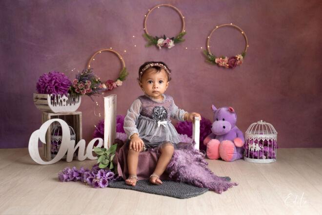 1st pre-birthday photo shoot purple setup in Pune