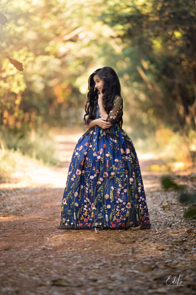 9 year old girl in beautiful long princess dress photography in forest in Pune by Edita
