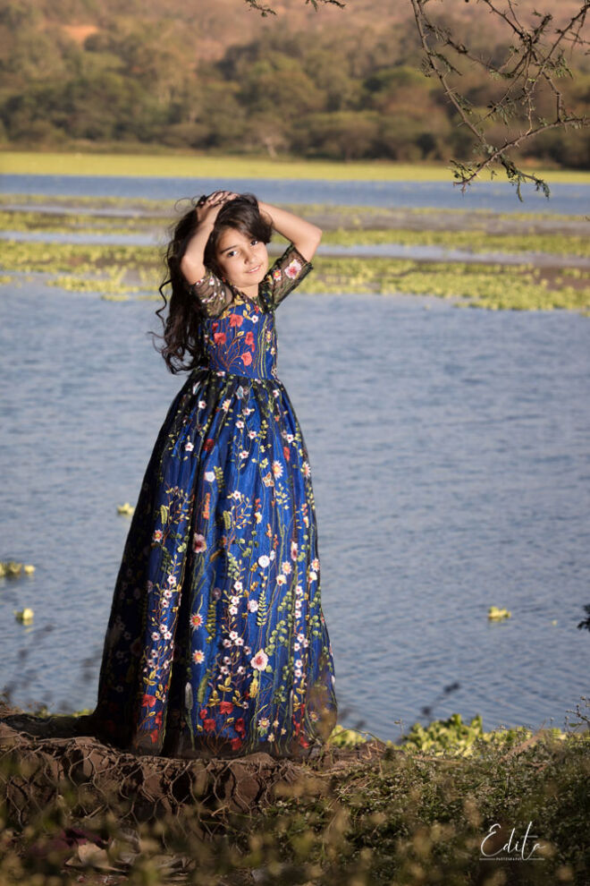 9 year old girl in beautiful blue dress with flowers photo near the lake in Pune