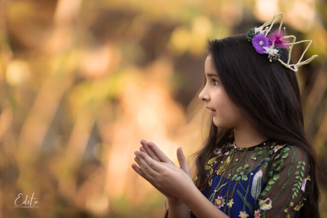 Girl with crown clapping hands photography near Pashan lake in Pune