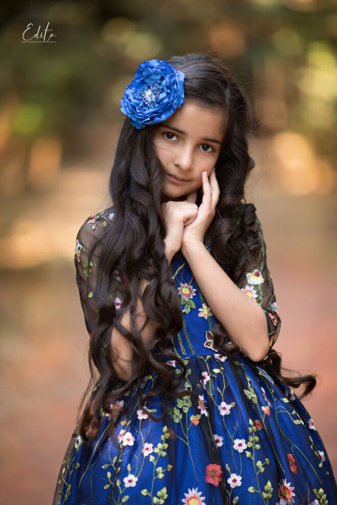 Children photo shoot in the forest, 9 year girl in blue gorgeous dress with flowers