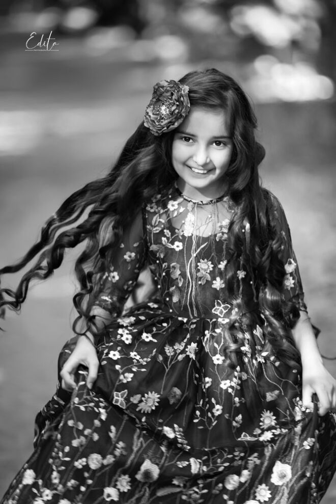 9 year old girl with long hair and long dress running in the forest