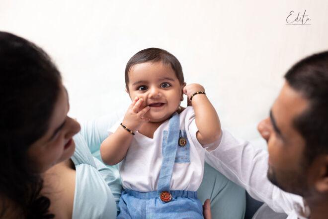 Baby boy in parents hands