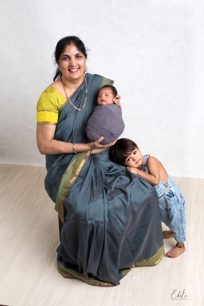 Indian grandmother in saree with 2 grandchildren photo