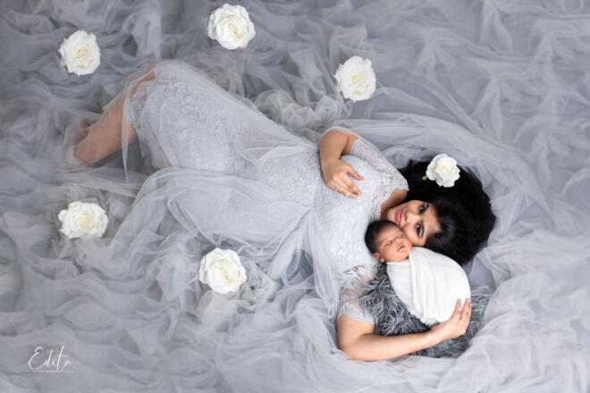 Mother aerial photo with newborn baby boy by Edita