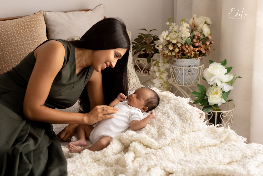 Mother and baby on bed, contactless covid-19 lifestyle newborn photoshoots in Pune