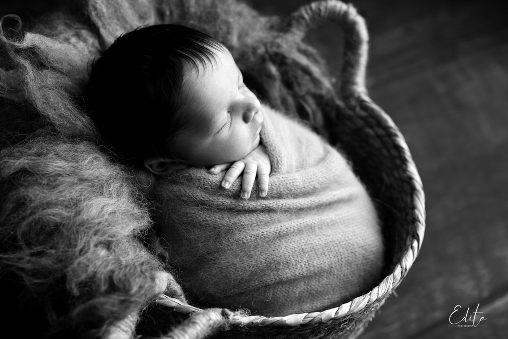Backlit black and white baby photo in basket