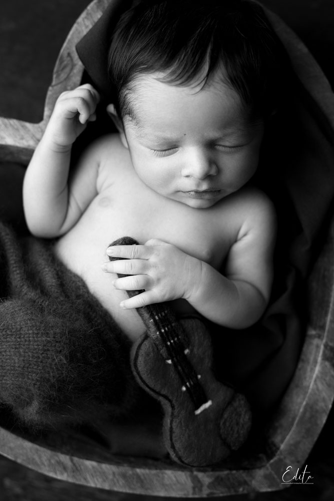 Black and white newborn with guitar photoshoot in Pune