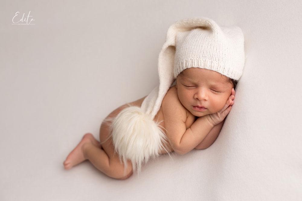 Newborn baby boy 15 days on beanbag with white hat