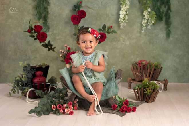 Green and red theme for 1st birthday photo shoot in Pune India by Edita photography