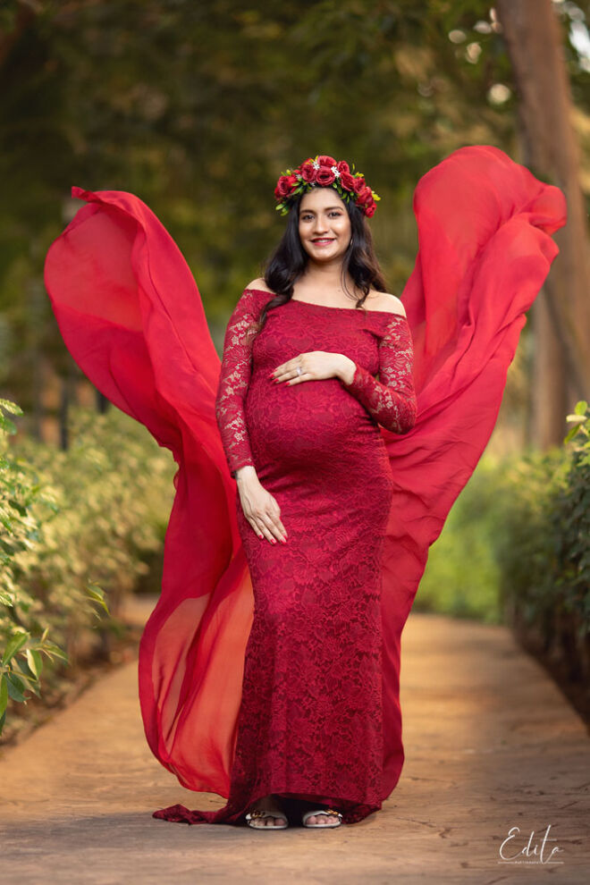 Maternity photography in red flying gown by Yulia Soloveva collection