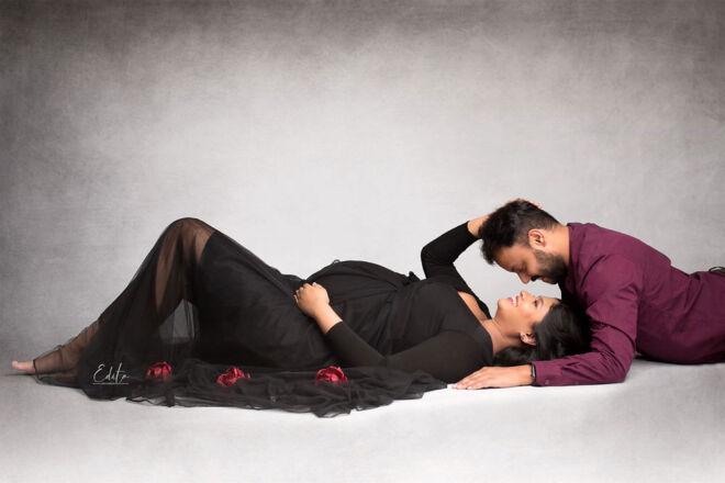 Maternity couple posing at studio