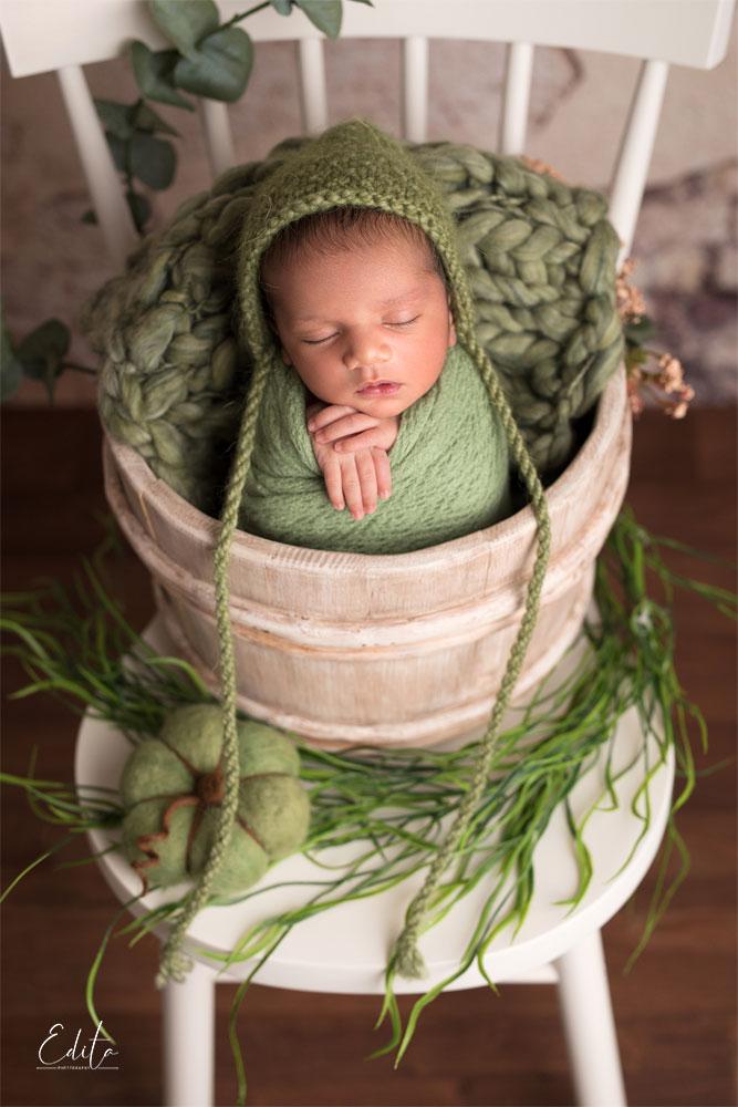 Newborn baby boy photoshoot in green and white