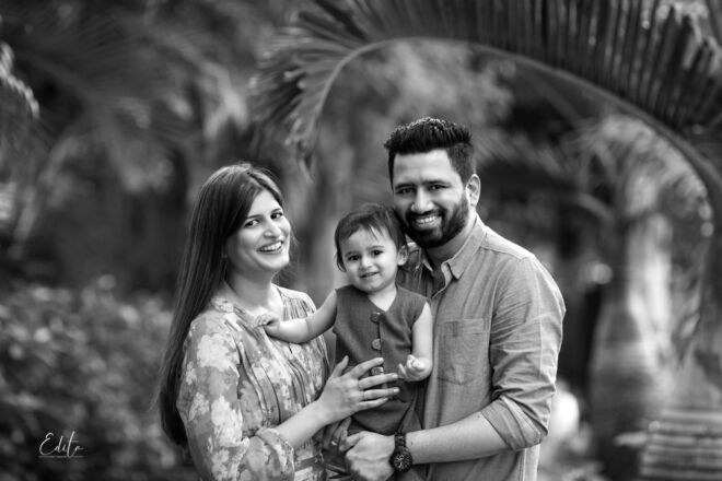 Family portrait with toddler in black and white