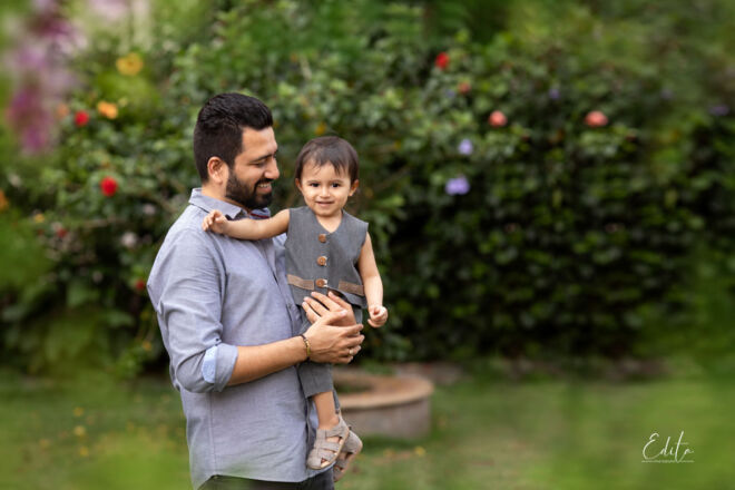 Father with toddler boy in garden photo shoot