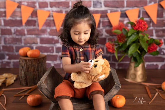 Pumpkin autumn theme setup for toddler photo shoot
