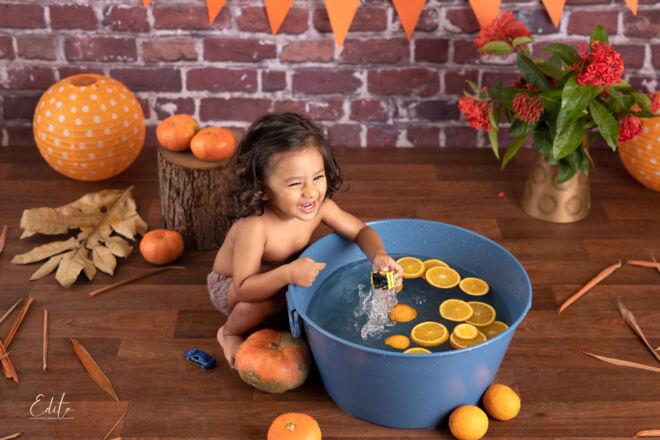 Toddler boy bath tub photos in autumn pumpkin setup