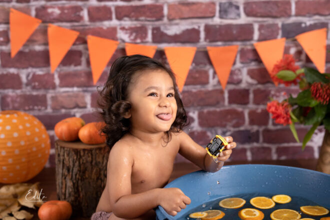 Toddler boy photos in autumn pumpkin setup